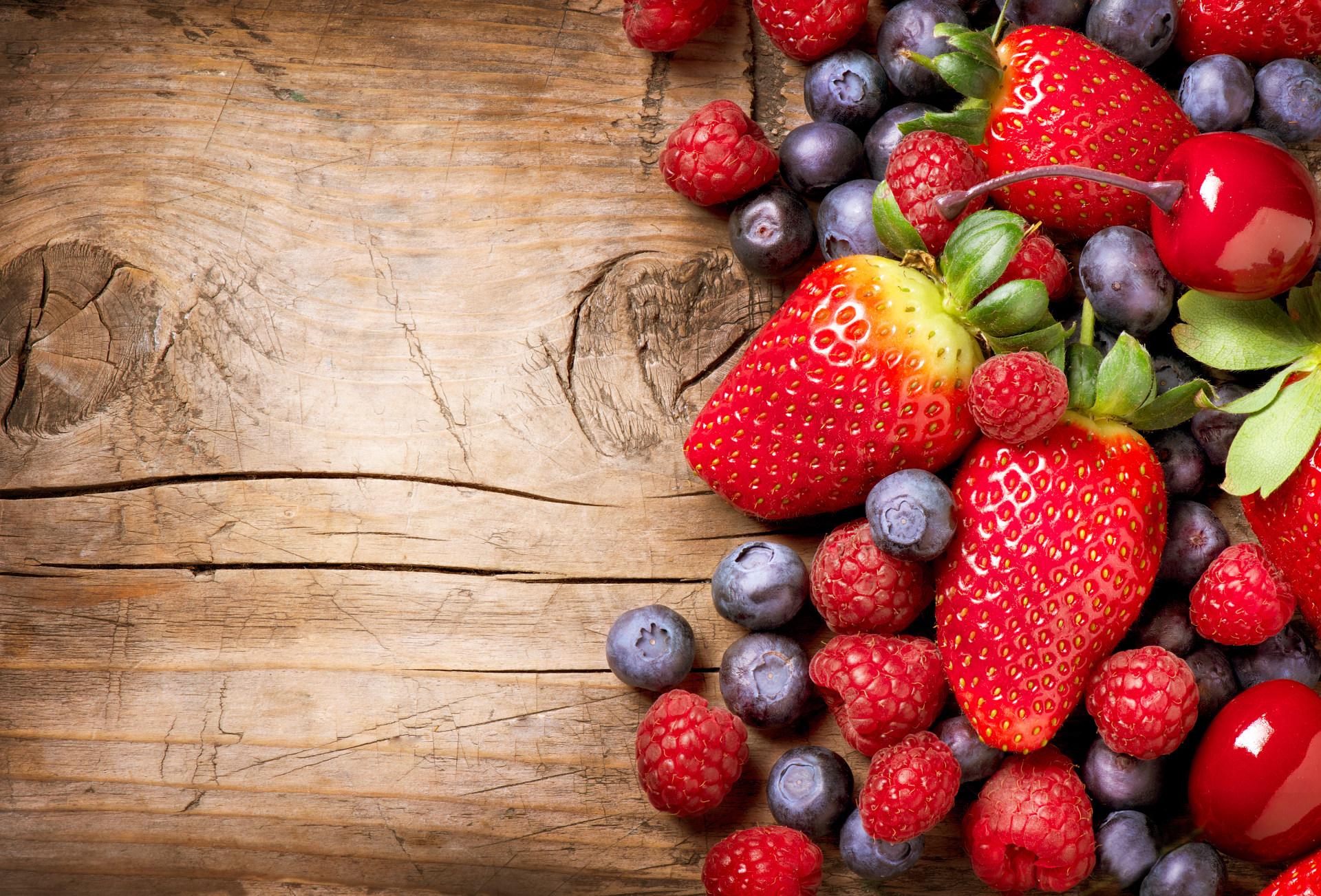 bigstock-berries-on-wooden-background-42586828_